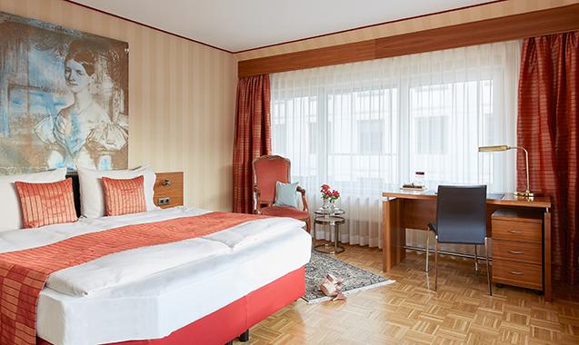 Living-Hotel-an-der-Oper-Wien-Superior-Bett